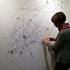 Artist Jehanne Paternostre sculpting the graphic representation of the Cavell Network